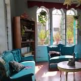 ファミリー ルーム ダブルベッド 1 台ソファーベッド付き - リビング エリア