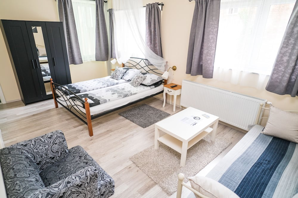 Deluxe Triple Room, Private Bathroom - Living Area