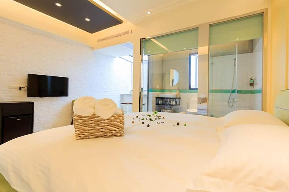 Dvojlôžková izba typu Deluxe - Sprcha v kúpeľni