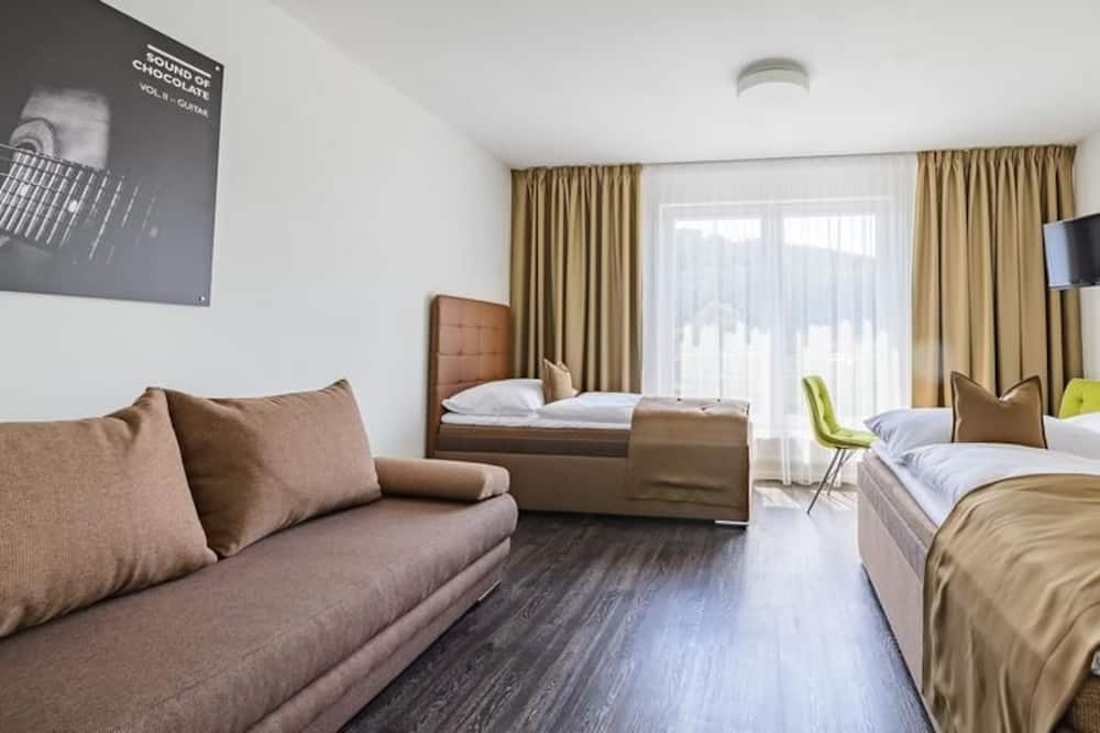 Habitación triple Deluxe, 1 habitación, cocina básica - Habitación