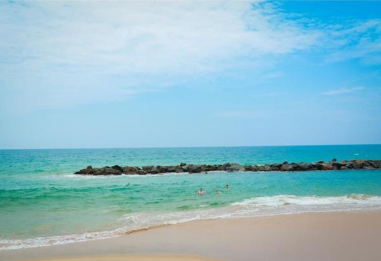 和諧海灘平房飯店, 唐加勒