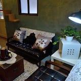 Chambre Quadruple (Brown Cat) - Coin séjour