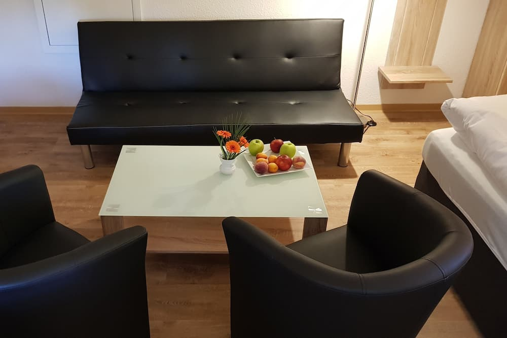 Junior suite (3 people) - Woonruimte