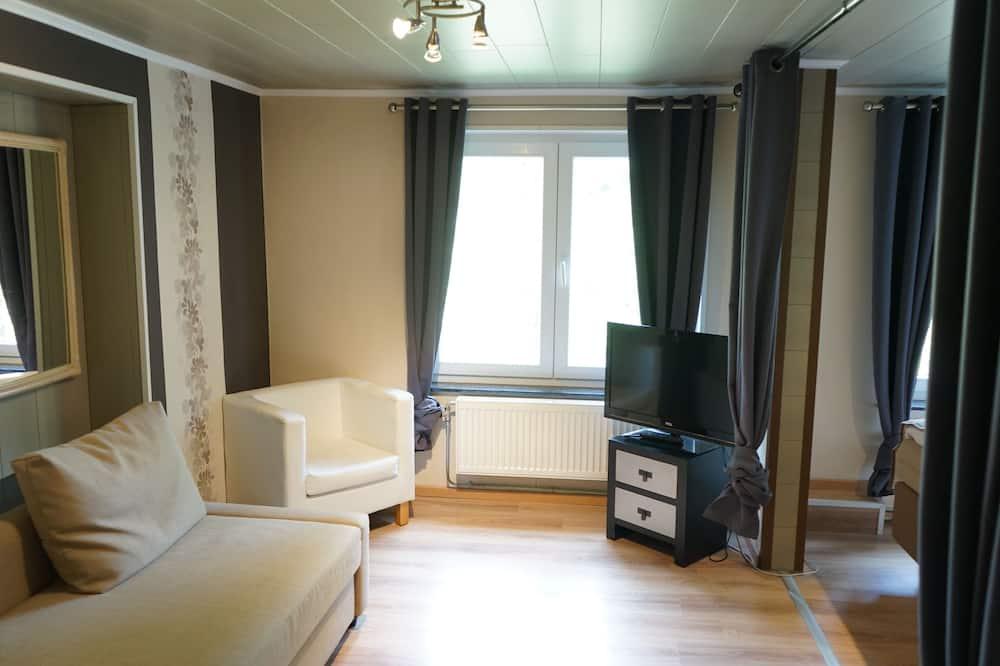 Habitación triple Confort - Sala de estar