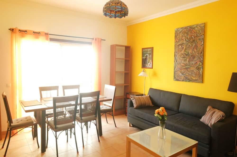 อพาร์ทเมนท์, 1 ห้องนอน, ระเบียง - ห้องนั่งเล่น