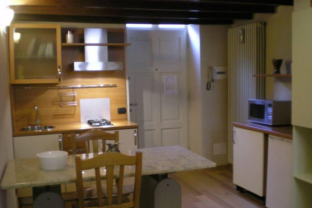 Suite estudio exclusiva, 1 habitación, cocina - Servicio de comidas en la habitación