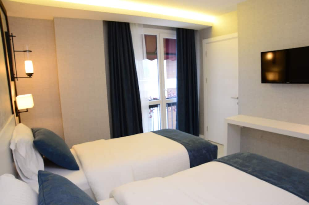 ห้องซูพีเรียสวีท, เตียงควีนไซส์ 1 เตียง และโซฟาเบด, วิวเมือง - ห้องพัก