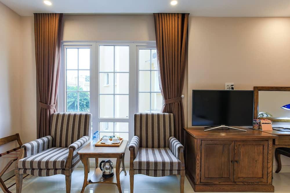Deluxe driepersoonskamer - Woonruimte