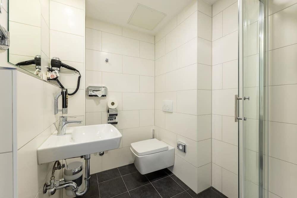 Regadera en el baño