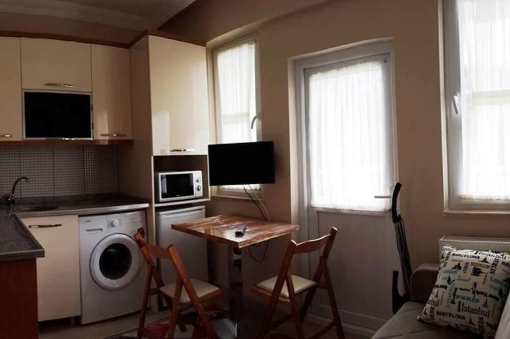 Standaard driepersoonskamer - Woonruimte