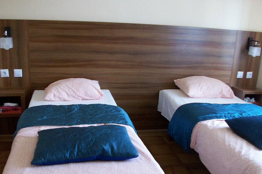Двухместный номер «Эконом» с 2 односпальными кроватями, 2 односпальные кровати - Номер