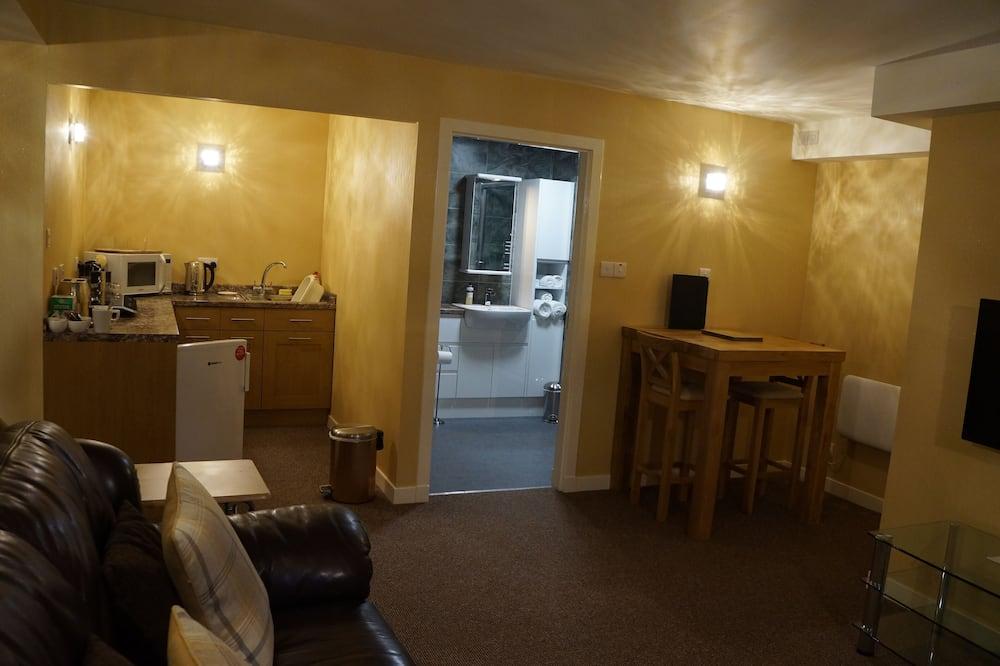 Apartamento Premium, várias camas, Rés-do-chão - Área de Estar