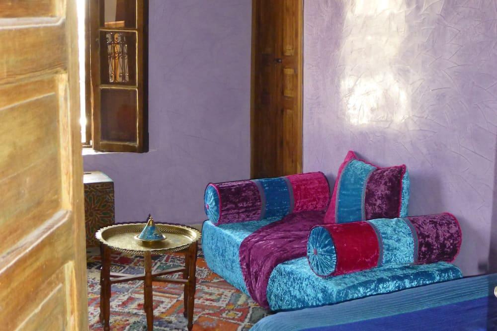 Quadruple Room, Hill View - Living Area