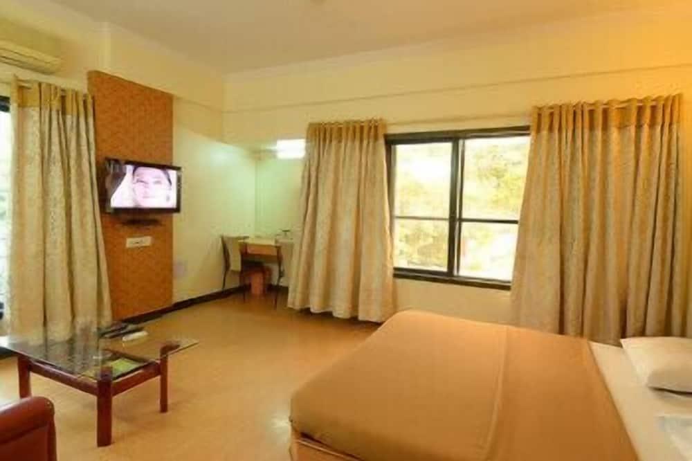 Family Single Room, 1 Bedroom, Smoking, City View - Ruang Tamu