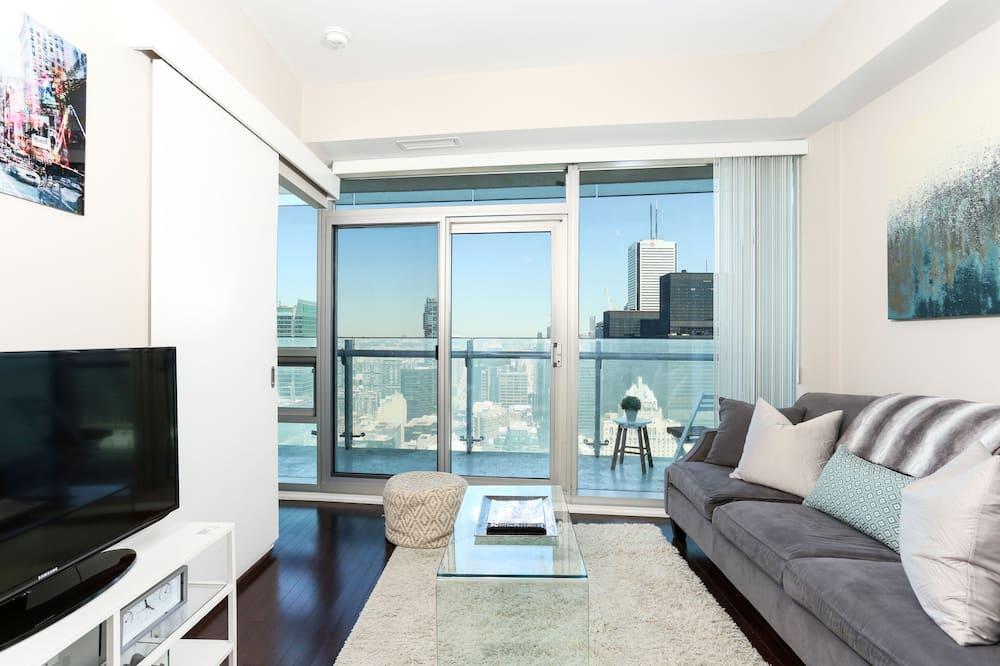 Departamento Deluxe, 1 habitación, vista a la ciudad, piso ejecutivo - Sala de estar