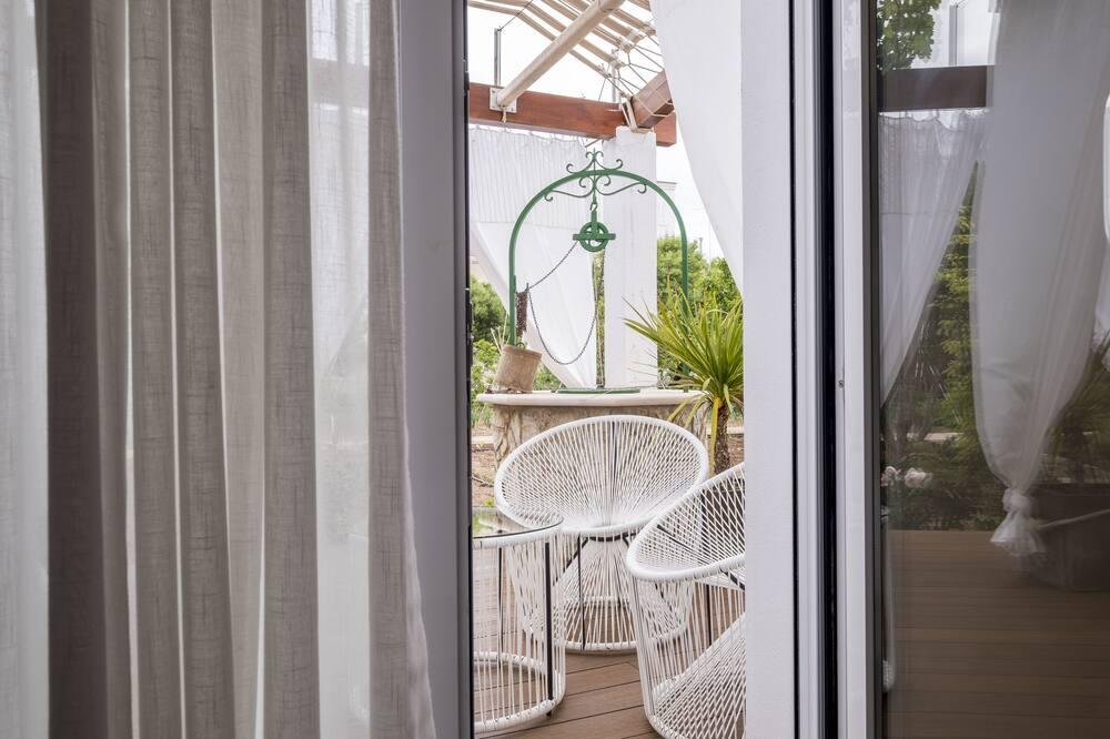 Kamar Double Deluks, teras - Pemandangan Kebun
