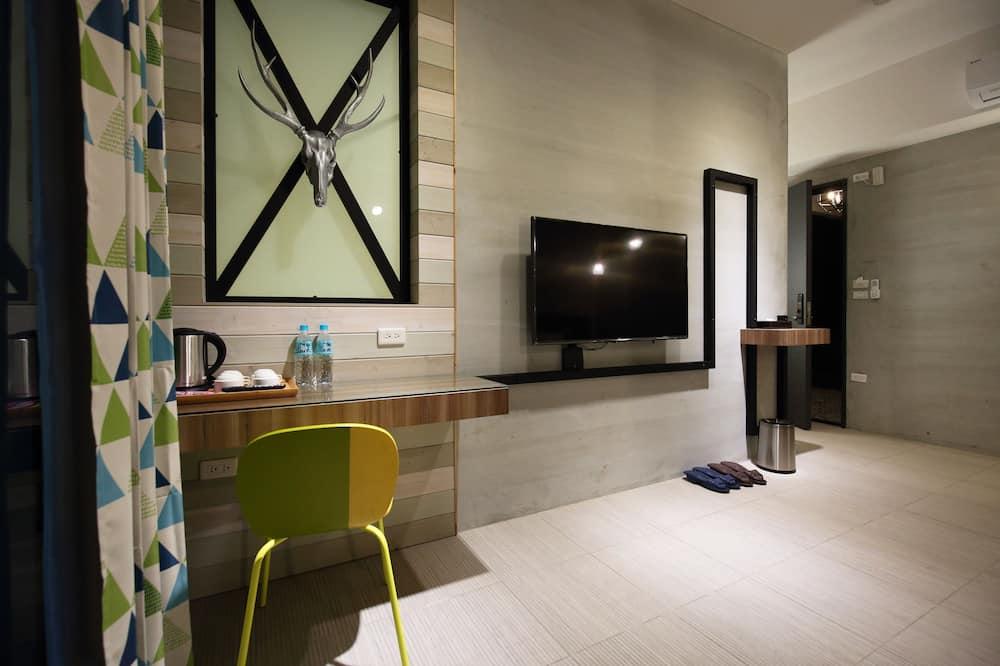 Comfort Quadruple Room - Living Area