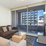 City appartement, 1 queensize bed met slaapbank - Woonruimte