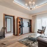 Suite, 1 habitación, balcón, vista a la piscina - Sala de estar