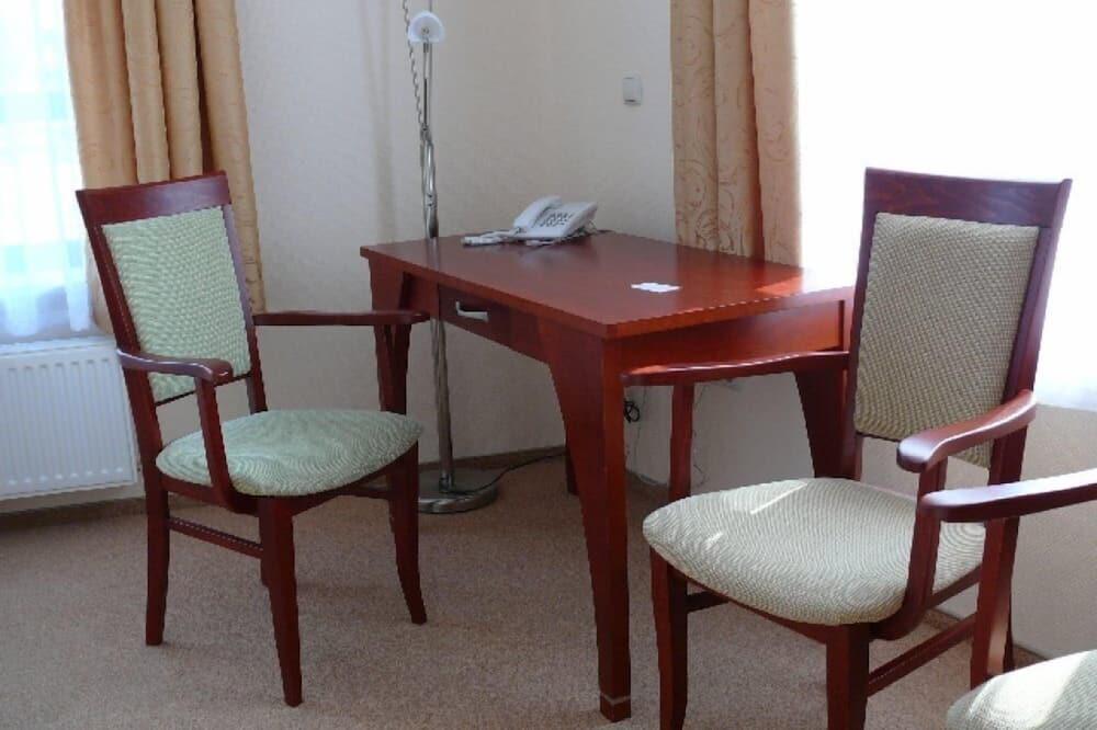 Liukso klasės vienvietis kambarys - Svetainės zona