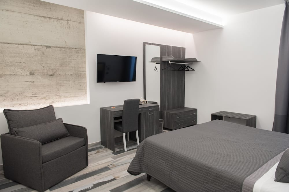 Habitación cuádruple familiar, baño privado - Zona de estar