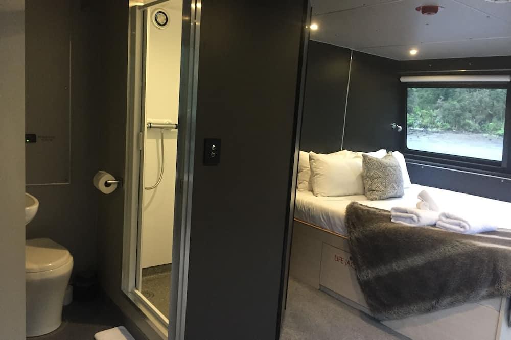 Darījumklases luksusa numurs, 1 divguļamā karaļa gulta, skats uz okeānu (Governors Suite) - Vannasistaba