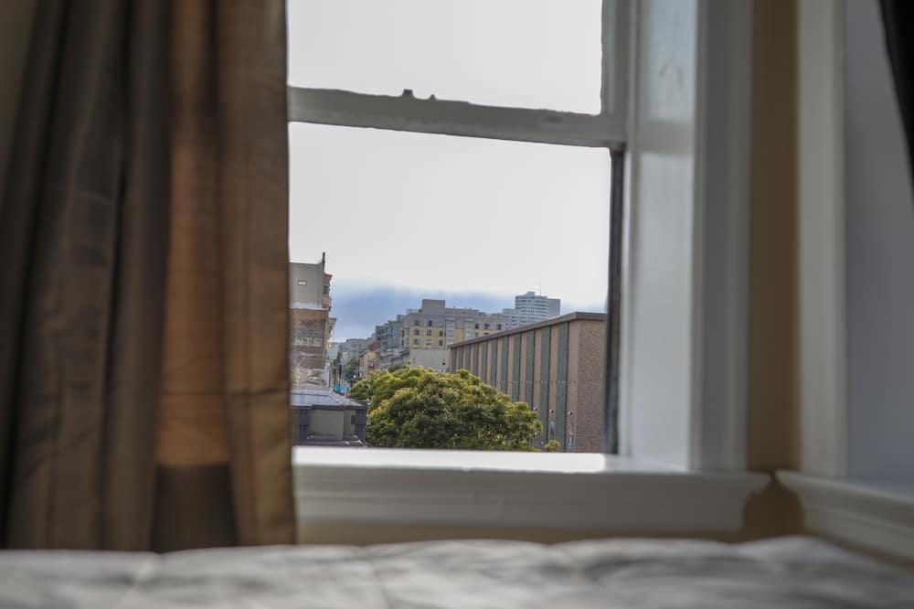 Habitación, 1 cama doble, baño compartido - Vista a la ciudad