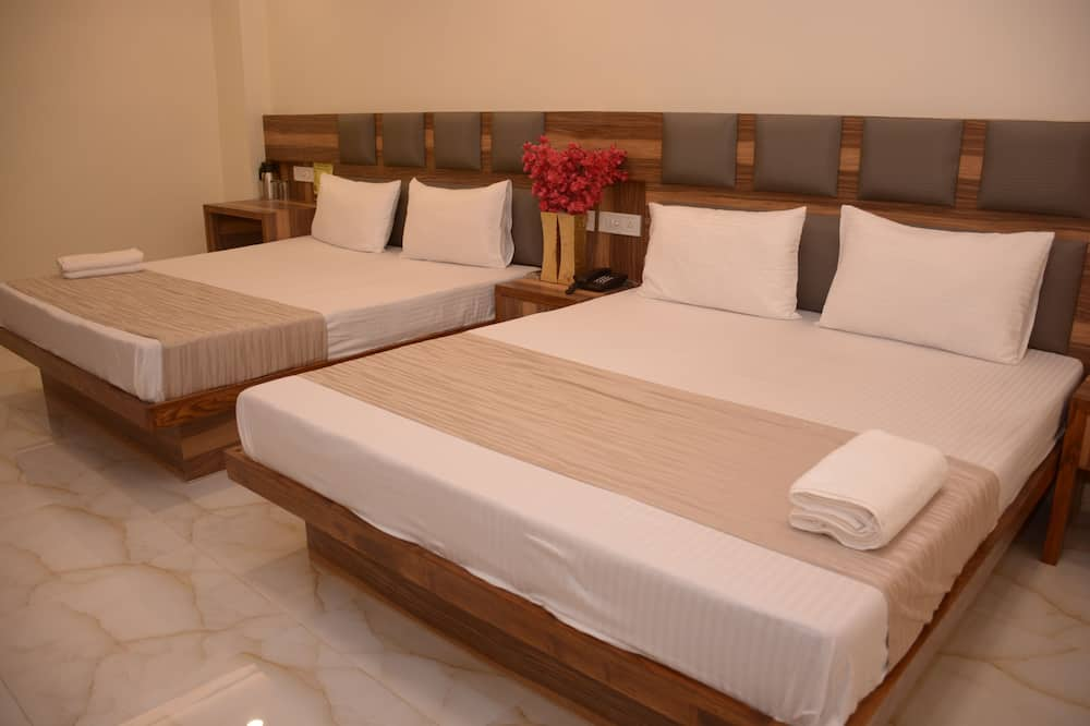 Deluxe Quadruple Room, Multiple Beds, Private Bathroom - City View