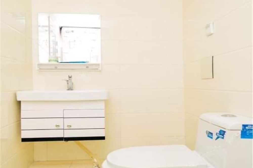 Deluxe-Vierbettzimmer - Badezimmer