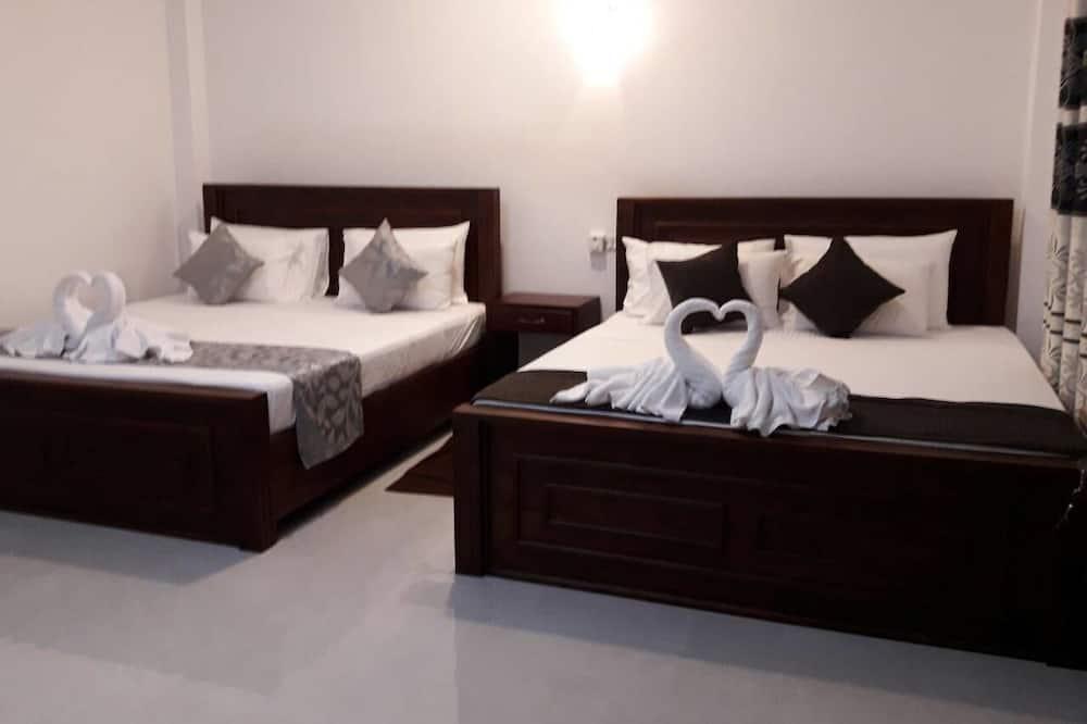 Ģimenes numurs, 2 divguļamās gultas - Dzīvojamā istaba