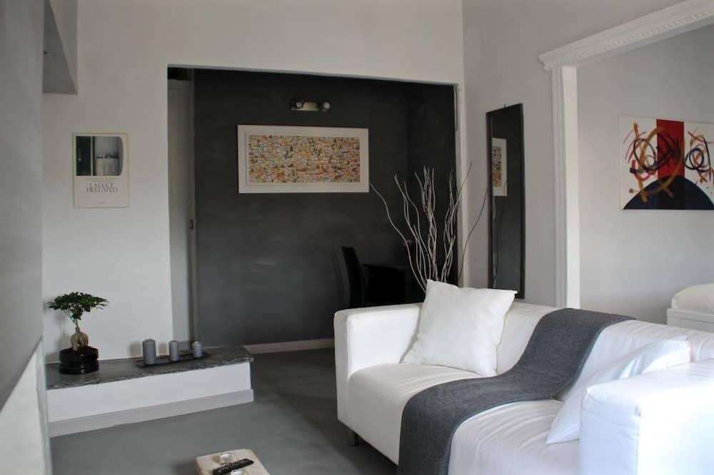 Двухместный номер «Делюкс» с 1 двуспальной кроватью, ванна - Зона гостиной