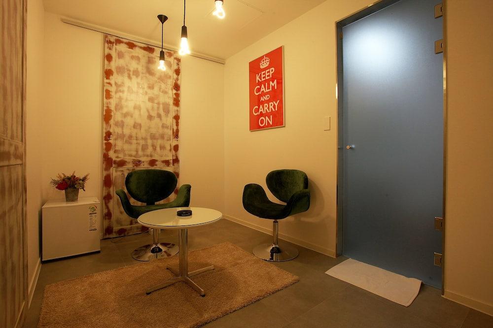 Deluxe-Zimmer, Flussblick - Wohnzimmer
