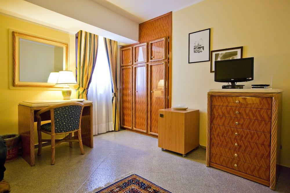 디럭스 쿼드룸, 침실 1개, 바다 전망 - 거실 공간