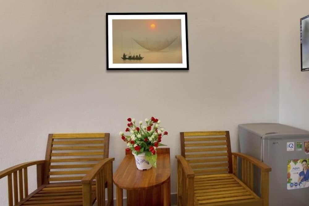 Deluxe szoba kétszemélyes vagy két külön ággyal - Nappali rész