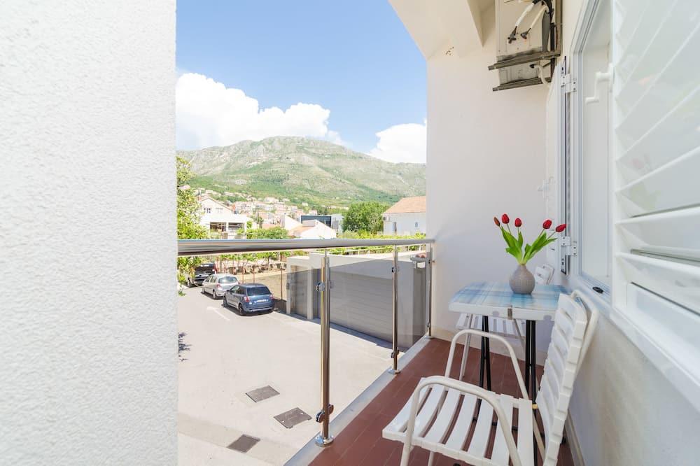 Apartamento Comfort, 1 Quarto, Varanda, Vista Jardim - Varanda