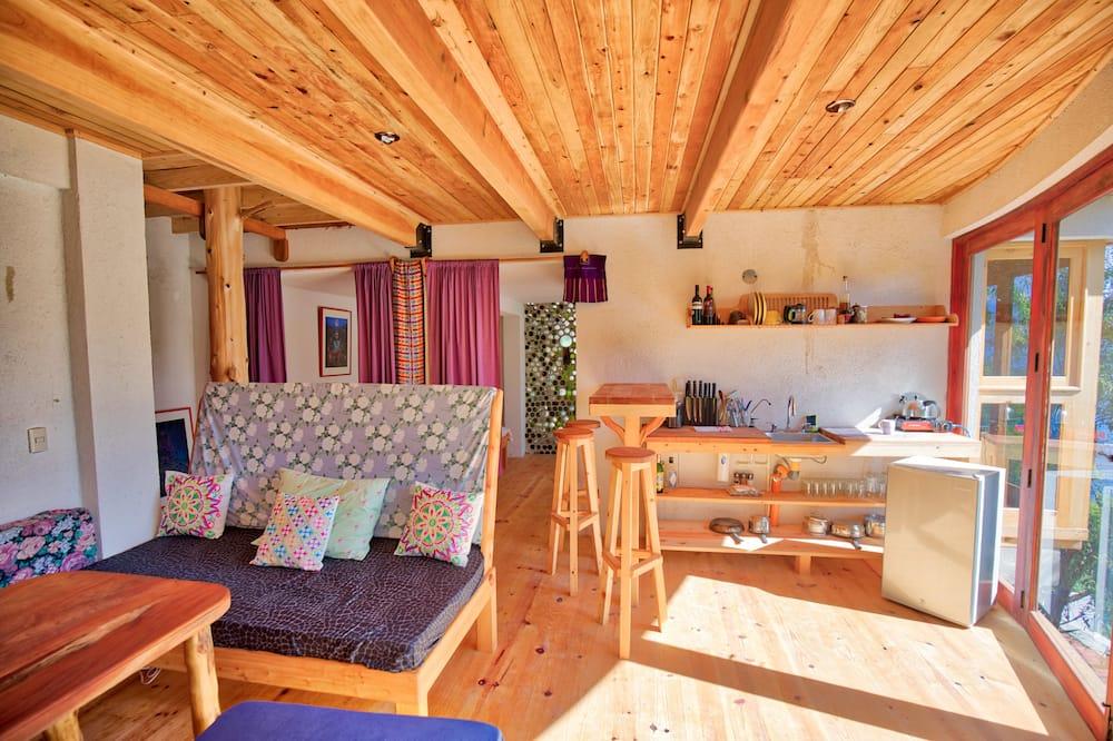 파노라믹 아파트, 더블침대 1개 및 소파베드, 정원 전망, 바다 정면 - 거실