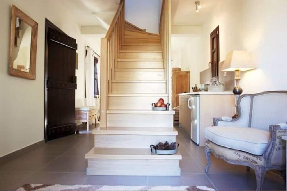 Hus - 2 soveværelser - pejs i værelset - Opholdsområde