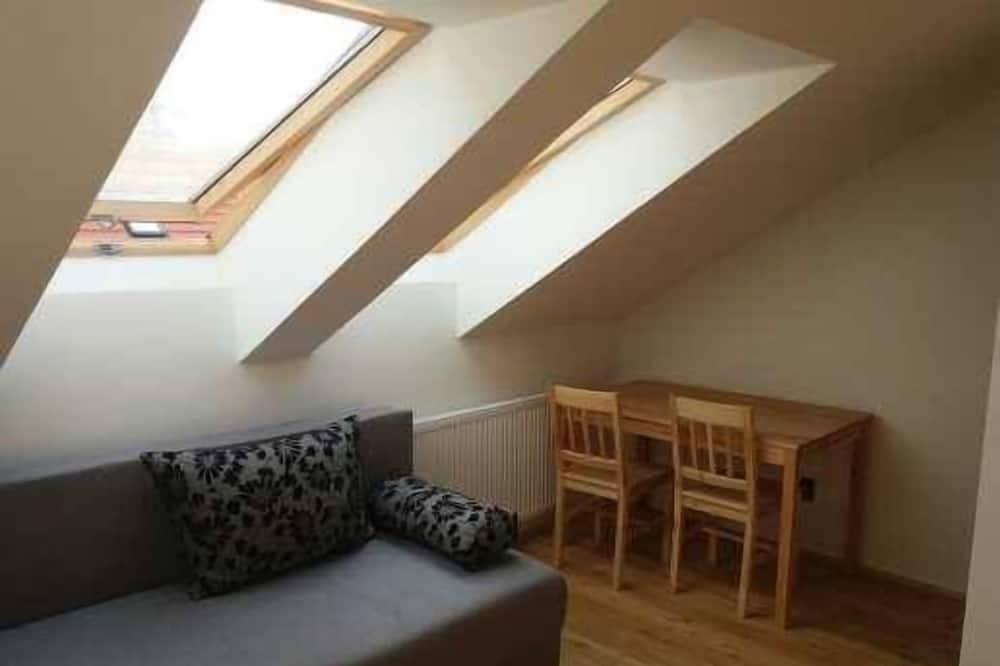 Quadruple Room, Courtyard Area - Living Area