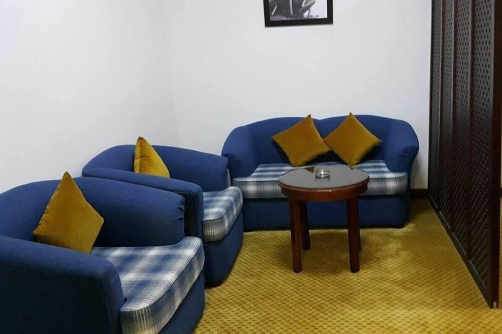 Deluxe-huone, 1 suuri parisänky - Oleskelualue