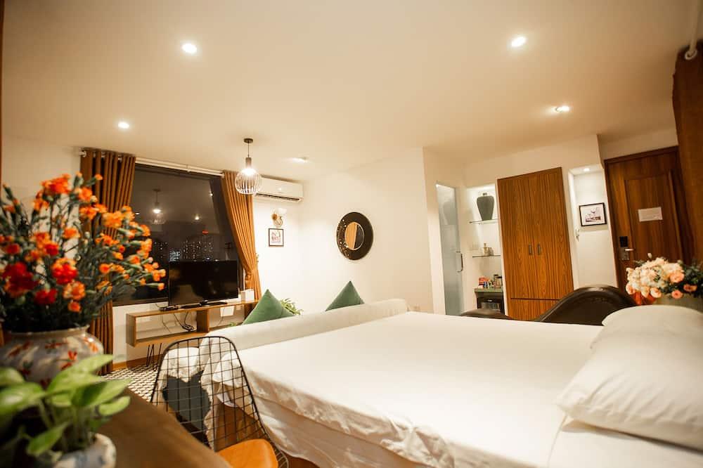 Signature-Suite, 1King-Bett, Terrasse, Stadtblick - Wohnbereich