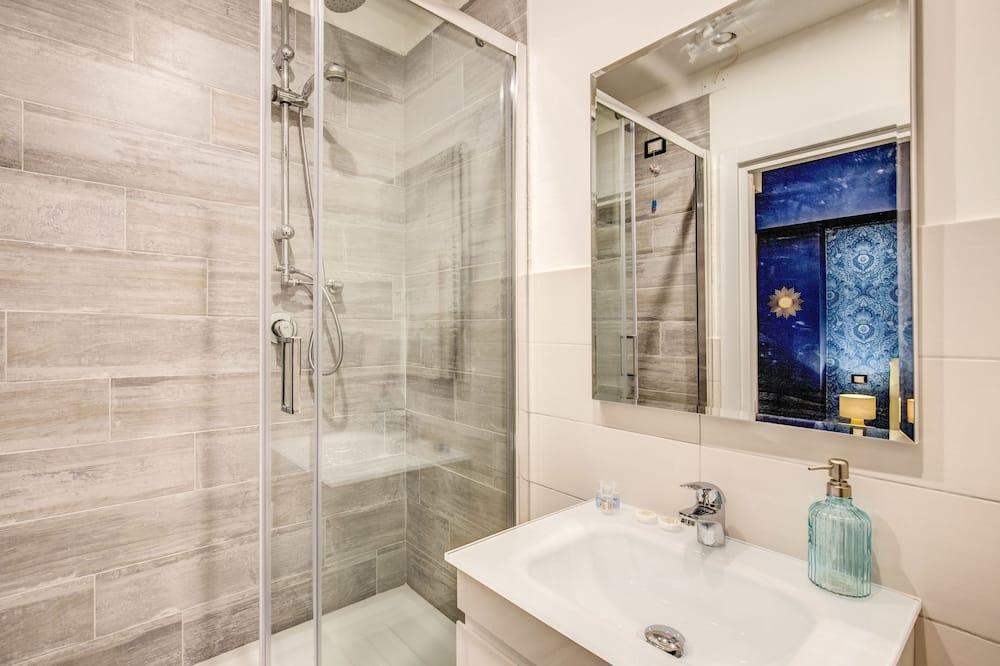 Pokoj Deluxe s dvojlůžkem - Koupelna
