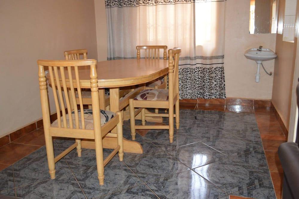 Comfort cottage - Eetruimte in kamer