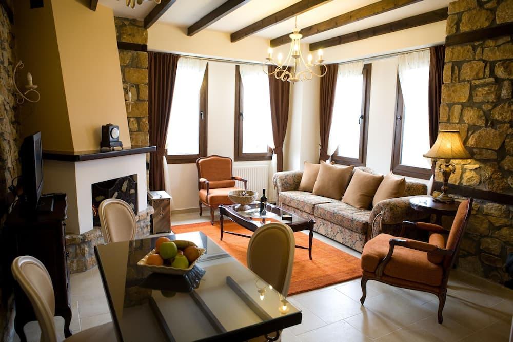 Suite de lujo, 1 cama King size con sofá cama, vista a la montaña - Sala de estar