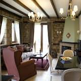 Suite de lujo, 1 cama King size con sofá cama, vista al jardín - Sala de estar