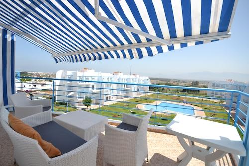 里维埃拉海滩复合式酒店/