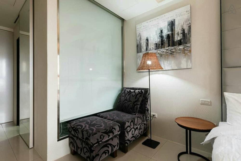 Habitación doble Deluxe, 1 habitación, para no fumadores, bañera - Sala de estar