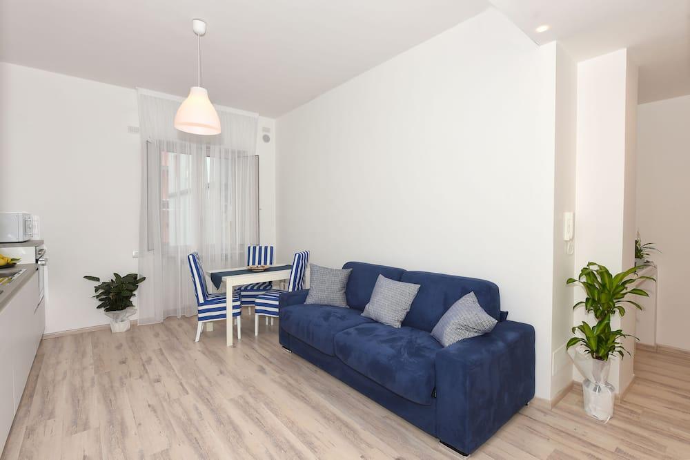 Apartamento superior, 1 habitación - Zona de estar