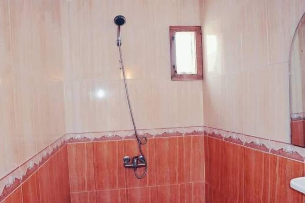 Dusj på badet