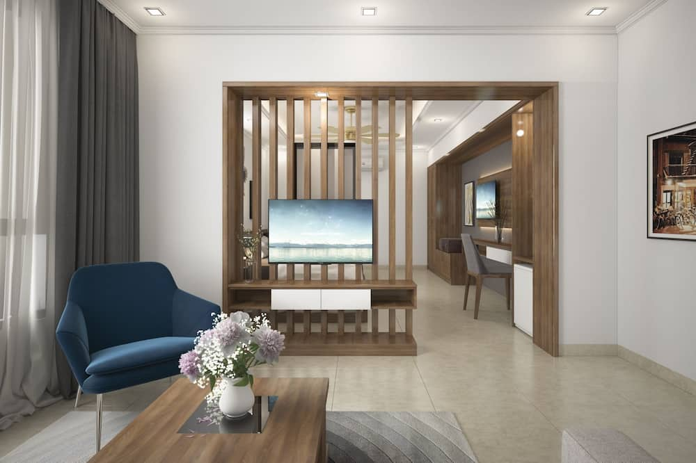 Suite, vista al mar - Sala de estar
