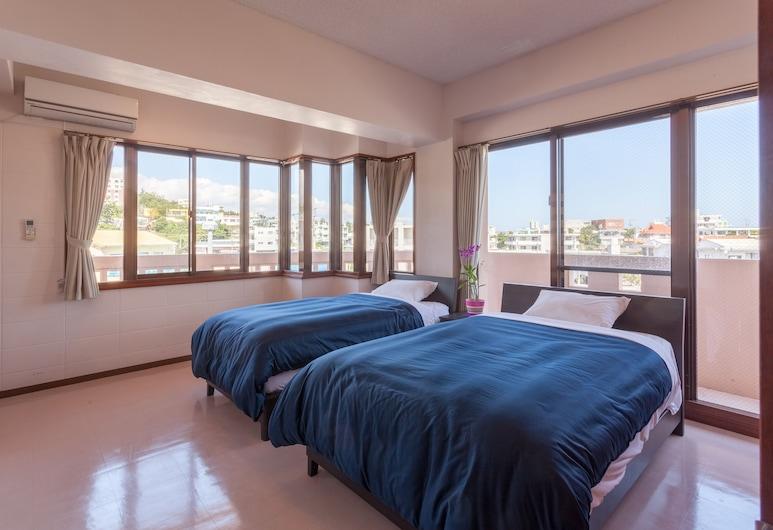 Kariyushi Condominium Resort Mezon Max, Okinawa, Apartmán typu Deluxe, Izba